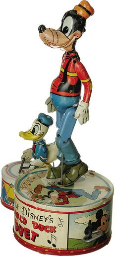 Vintage Walt Disney's Goofy and Donald Duck tin litho wind-up toy duet by Marx. Photo from Tom Simpson on Flickr.