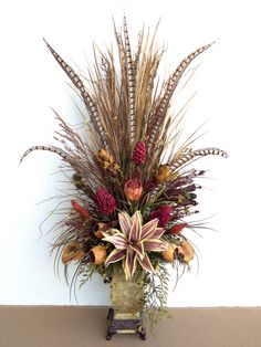 Dried floral mixed arrangement for foyer console designed by Arcadia Floral & Home Decor.