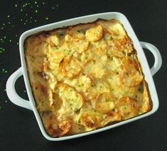 Garlic Cheesy Potatoes - baked in a lightened-up creamy sauce, these are the ultimate comfort food. | sliceofkitchenlife.com