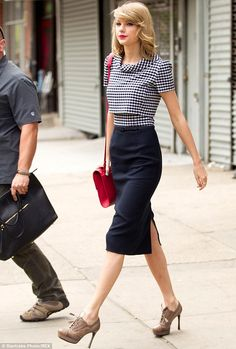 Leggy lady: Taylor Swift was spotted strolling about in New York City the next morning - Sunday - looking chic and stylish in a tailored skirt