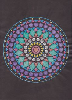 Beautiful mandala colored by Kathie Alder Fenske and posted to our Coloring with Dover Facebook page: www.facebook.com/dovercoloring