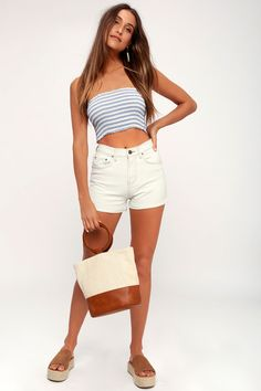 From the high tide to the low tide, the Billabong High Tide Light Wash High Waisted Denim Shorts will keep on rocking! These classic denim shorts have a high-waisted fit, and a classic five pocket cut. Overall fading and cuffed hems complete the look. Waisted Denim, High Tide, Denim Overalls, Billabong, White Shorts, Fitness, Cotton, Clothes, Tops