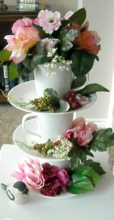 Someone I know just made one of these towers with tea cups and tea pots. Was it Miriam? Love the addition of the flowers, here.
