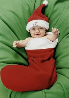 Baby in a stocking christmas picture @lexi Pixel Jimenez-Davila omg can we do this to Daniella!