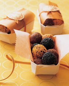 Give your guests a sweet send-off. Nestle homemade truffles decorated with sprinkles in little wooden boxes. Ours are lined with glassine -- trimmed with scallop scissors -- then wrapped in narrow ribbon and sealed with pumpkin stickers.