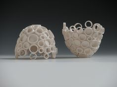 Porcelain Ceramic Art.  Wheel Thrown, Hand-built, Vases and Vessels for light and home installation.  Katherine Dube; Dube Ceramic Art and Design 2010