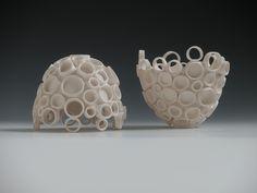 Porcelain Ceramic Art.  Wheel Thrown, Hand-built, Vases and Vessels for light and home installation.  Katherine Dube; Dube Ceramic Art and Design 2010