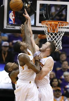 Portland Trail Blazers' Damian Lillard, left, tries to get off a shot over Phoenix Suns' Miles Plumlee (22) during the second half in an NBA basketball game on Wednesday, Oct. 30, 2013, in Phoenix. The Suns defeated the Trail Blazers 104-91. (AP Photo/Ross D. Franklin)