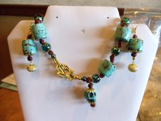 This is the back of the turquoise necklace which I added a turquoise skull, plus the earrings.