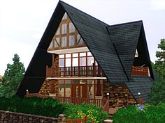 Large A-Frame House | This A-frame house feature a basement, underground garage, a large ...