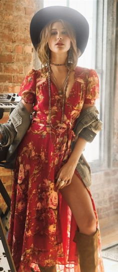 Denim & Supply model, Hailey Baldwin, shows off the new effortless wrap dress for the season. Romantic florals and a flowing wrap silhouette make this cotton gauze dress a chic warm-weather style.