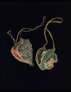 Walnut shell covered in silk, embroidered with silk and metal thread. lined with silk.