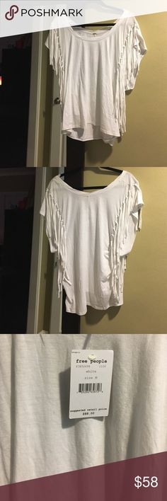 🎉sale🎉NWT Free People shirt NWT, Free People shirt in a size medium. Large armholes and a high low hem. No stains, tears, rips, or pilling. From a pet friendly environment. Listed at $58 Free People Tops Tees - Short Sleeve