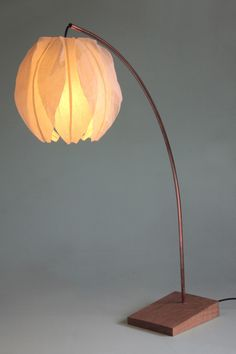 KOZO LEANING DESK LAMP Japanese Kozo Paper shade. Made from Mulberry bark, the long fibres allow the paper to be thin to let the light through but very strong. Copper stem with oak base. 95 cm high, Shade 27 cm diameter also available separately as pendant shade. Max 20 watt energy saver light bulb