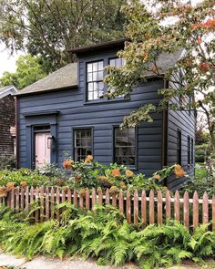 I know I've been down this road before shooting this fav blue cottage, but I couldn't resist the dried hydrangeas against the weathered fence. The beginnings of fall colors just looked too beautiful not to share. Black House Exterior, Cottage Exterior, Cabana, Cabin In The Woods, Art Deco Home, Cabins And Cottages, Cabin Homes, Cottage Homes, Exterior Paint