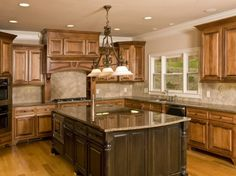Kitchen, Attractive best kitchen island large rectangle brown marble counter top hardwood material brown finish drawer and door storage island base light brown wood cabinet white island lighting: Best Kitchen Island