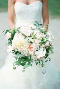 A loose bouquet comprised of dahlias, garden roses, jasmine vine, and foraged greenery, created by Munster Rose.