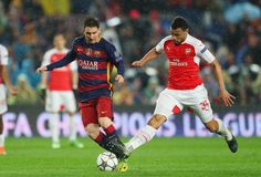 Lionel Messi of Barcelona and Francis Coquelin of Arsenal compete for the ball during the UEFA Champions League round of 16, second Leg match between FC Barcelona and Arsenal FC at Camp Nou on March 16, 2016 in Barcelona