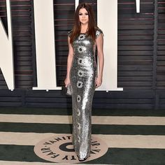 Selena Gomez wears a silver metallic Louis Vuitton gown designed by Nicolas Ghesquière to the 2016 Vanity Fair Oscar After Party.