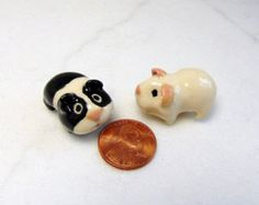This tiny micro mini pink and tan colored guinea pig terrarium figurine was hand sculpted and handmade from white stoneware clay. No molds