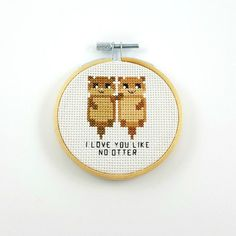 I finished this cute little otter cross stitch. I love you like no otter. You can find the pattern. Geek Cross Stitch, Small Cross Stitch, Cross Stitch Cards, Cute Cross Stitch, Cross Stitch Animals, Counted Cross Stitch Patterns, Cross Stitch Designs, Cross Stitching, Embroidery Hoop Art