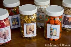 all saints guessing jar game -- I love this! Pumpkin's in St. Isadore's jar, rose shaped soaps in St. Therese's jar, etc.  Very creative!