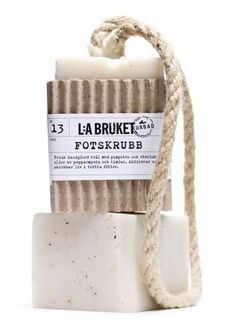 Rustic packaging for soap on a rope.