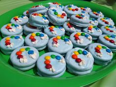These are dipped oreos, decorated with mini M and tiny pieces of marshmallows.  These oreos were the birthday cake edition so they were different colors inside adding to the rainbow fun.