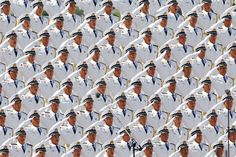Members of a military band sing during a military parade in Beijing on September 3, 2015.