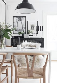 Wishbone chair by Hans J wegner from Carl Hansen. Black, white & natural wood.