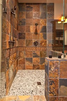 """Great color for the shower tiles make for a """"rustic"""" bathroom."""