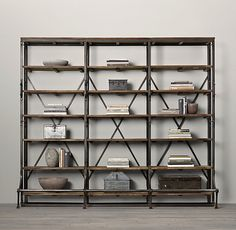 RH's French Library Triple Shelving:A reproduction of a mid-1940s eastern European library bookcase, ours is heir apparent to the imperfect beauty of an antique. Crafted from iron and hardwood, it displays books and other collectibles from four open sides. Distressed to replicate its forebear with the patina of age, our shelving's front handles and lower bar step are functional vestiges of its earlier employment, equipping it for moves and reaching the upper tiers as necessary.