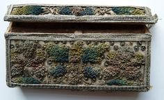 Needle case  An embroidered metal thread, sequin and silk rectangular case with a hinged lid, decorated with sprays of flowers, sequins and silver thread borders.