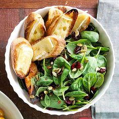 Try this bold spinach salad recipe that features slices of Brie cheese-topped toast and a creamy cranberry dressing.