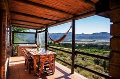 A lovely dining area on the stoep at Wolfkop Nature Reserve Mountain Cottages in Citrusdal. Gazebo, Pergola, Mountain Cottage, Weekends Away, Nature Reserve, Outdoor Seating, Dining Area, South Africa, Outdoor Structures