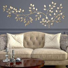 Give your home a modern upgrade with this charming Stratton Home Decor flowing leaves wall decor.