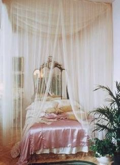 I am not sure I'd want this fancy of a room, but look at that silky pink bedspread....I'll take it!