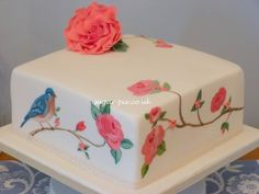 Hand painted bird and rose cake