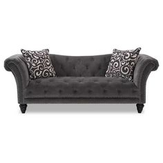 The Reston Tufted Thunder collection from Emerald Home Furnishings is inspired by original designs with a modern flair. Accents include extensive tufting, hi leg profile legs and sophisticated accent pillows.
