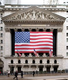 Lower Manhattan - New York Stock Exchange in New York City, USA Author: Arnoldius No known dimensions of American flag placed after 9/11.