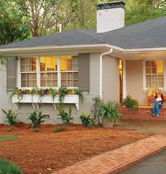 add window boxes...house the same colors...would work beautifully.  Shopping List: window boxes, metal L brackets for mounting box, screws or bolts (made from wood or masonry, depending on house), drill bit (for wood or masonry), decorative brackets to cover metal supports     Tools: tape measure, pencil, drill with appropriate bit