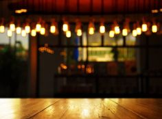 wood background blur lamp in pub or bar at night
