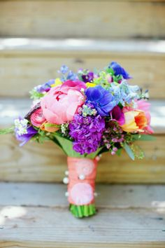 I LOVE this. I would like this one to be the inspiration for the bridal bouquet. The flowers are the right colors (bright but complimentary) and it looks soft (not too structured, and with some 'fluffy' looking flowers)