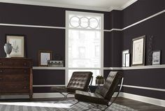 Deep Forrest Brown from Sherwin Williams but I love the wide chair-rail for setting art on.