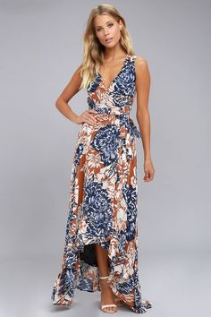 Lulus Exclusive! The Desert Trip Rust Orange Floral Print High-Low Wrap Dress is a day trip stunner! Lightweight woven chiffon, in a rust orange, white, and navy blue floral print, sweeps across a sleeveless wrap bodice, with waist tie, into a ruffled, high-low skirt.