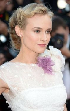 Diane Kruger wore a pretty floral boutonniere at the neckline of her ethereal white gown. Via www.zoolz.com