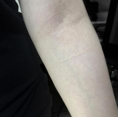 'Fearless' forearm tattoo in white ink by Hadya Natassya