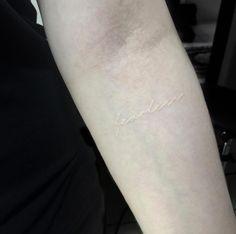 'Fearless' forearm tattoo in white ink by Hadya Natassya
