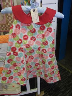 This is one of many baby/girls dresses we sell in our shop made by a very talented lady in Devon.