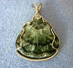 Pretty seraphinite  wire wrapped pendant by EileensBeadedJewelry #seraphinitependant #wirewrappedstone